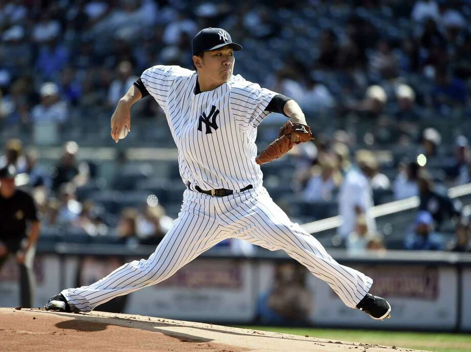 Yankees starter Masahiro Tanaka delivers a pitch in the first inning Sunday. Photo: Kathy Kmonicek — The Associated Press   / FR170189 AP