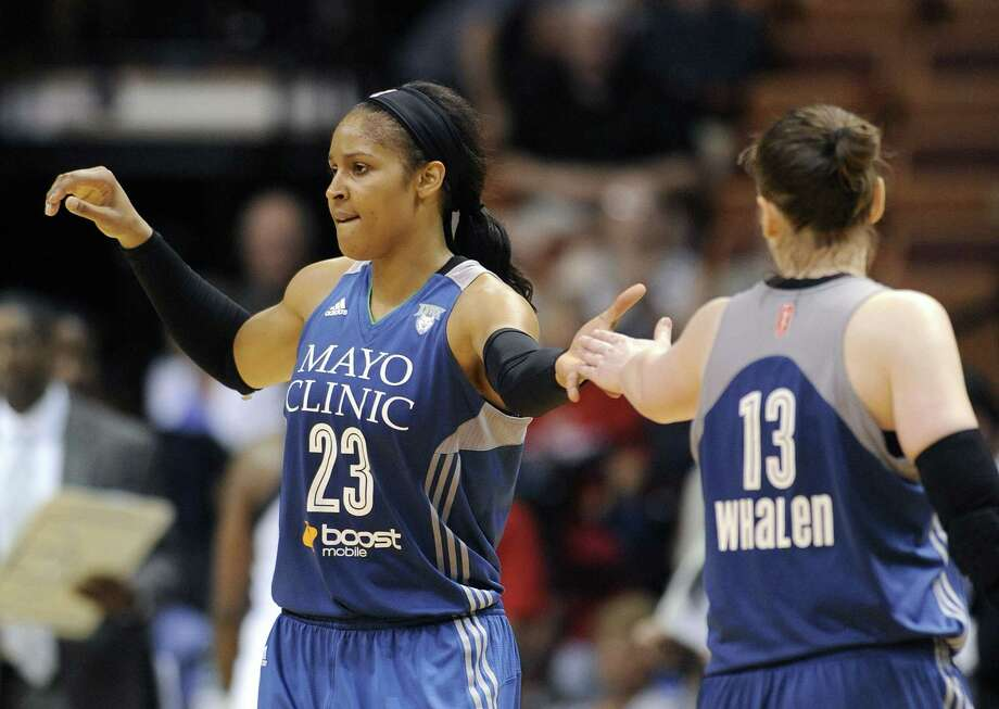 The Lynx's Maya Moore (23) celebrates with Lindsay Whalen late in the second half of an 85-79 victory over Connecticut in a WNBA game in Uncasville on Tuesday. Photo: Fred Beckham  — The Associated Press   / FR153656 AP