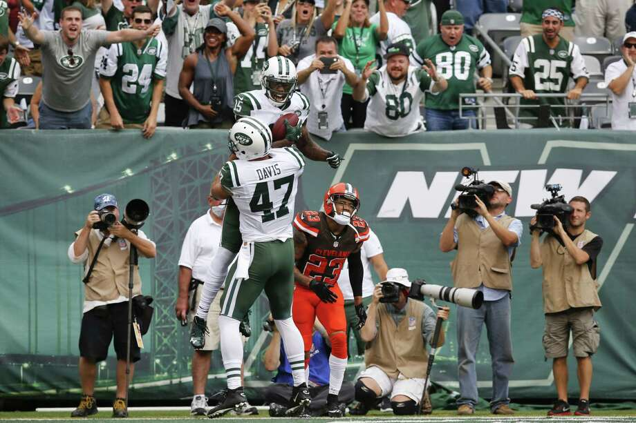Jets wide receiver Brandon Marshall (15) celebrates with teammate Kellen Davis after catching a pass for a touchdown during the second half Sunday. Photo: Kathy Willens — The Associated Press   / AP