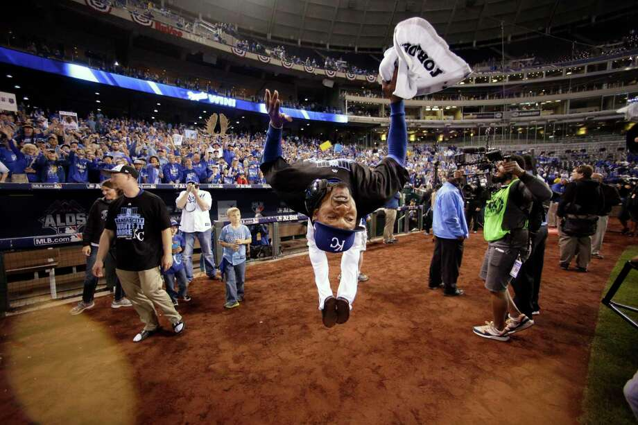 Royals center fielder Jarrod Dyson does a backflip on the field as he celebrates his team's 7-2 win over the Houston Astros in Game 5 of the American League Division Series. Photo: Charlie Riedel  — The Associated Press   / AP