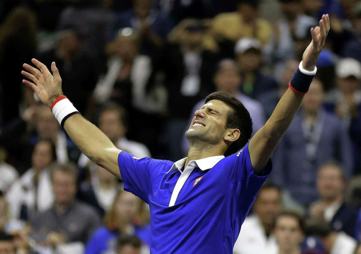 Novak Djokovic reacts after defeating Roger Federer to win the U.S. Open on Sunday.