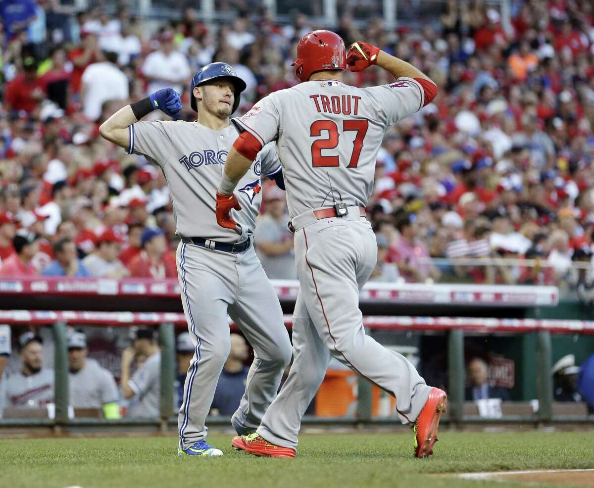 The American League's Mike Trout, of the Los Angeles Angels, celebrates with Josh Donaldson, of the Toronto Blue Jays, after Trout hit a lead-off home run in the first inning of the MLB All-Star Game.