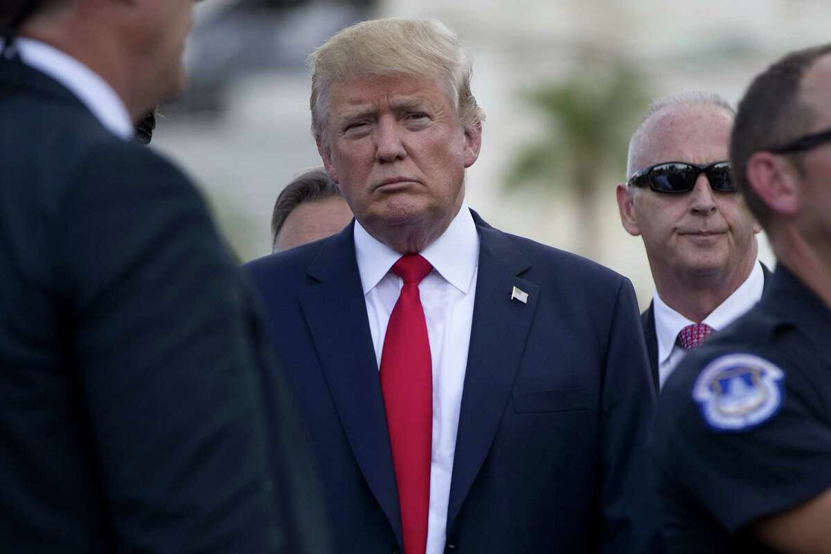 Republican presidential candidate Donald Trump stands near the stage as he waits to speaks at a rally organized by Tea Party Patriots in on Capitol Hill in Washington on Sept. 9, 2015 to oppose the Iran nuclear agreement.