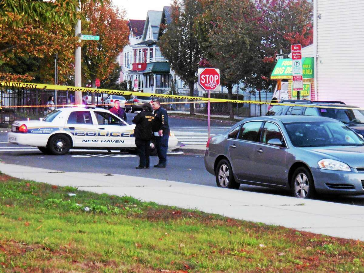 New Haven police search for clues after a man was found dead Tuesday on Davenport Avenue.