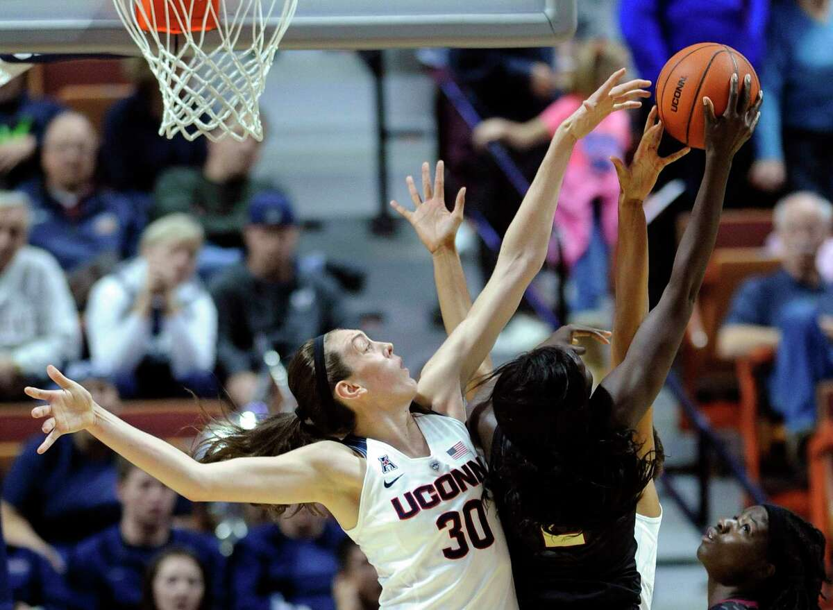 UConn's Breanna Stewart, left, blocks the shot of Florida State's Audut Bulgak during the first half Friday.