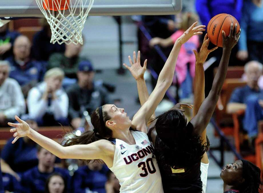 UConn's Breanna Stewart, left, blocks the shot of Florida State's Audut Bulgak during the first half Friday. Photo: Fred Beckham — The Associated Press   / FR153656 AP