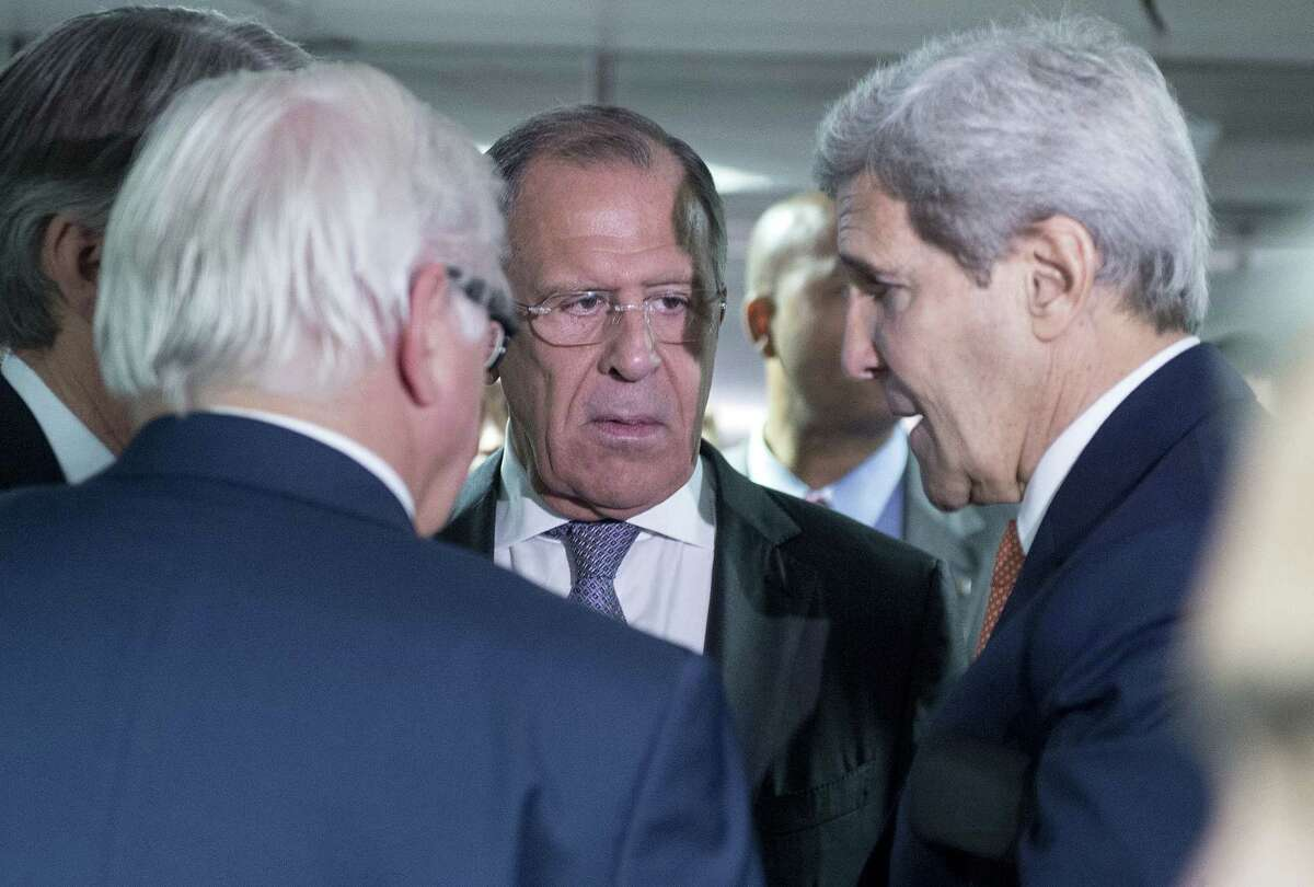 German Minister for Foreign Affairs Frank-Walter Steinmeier, left, Russian Foreign Minister Sergey Lavrov, center, and US Secretary of State John Kerry talk prior to the last plenary session at the United Nations building in Vienna, Austria on July 14, 2015.