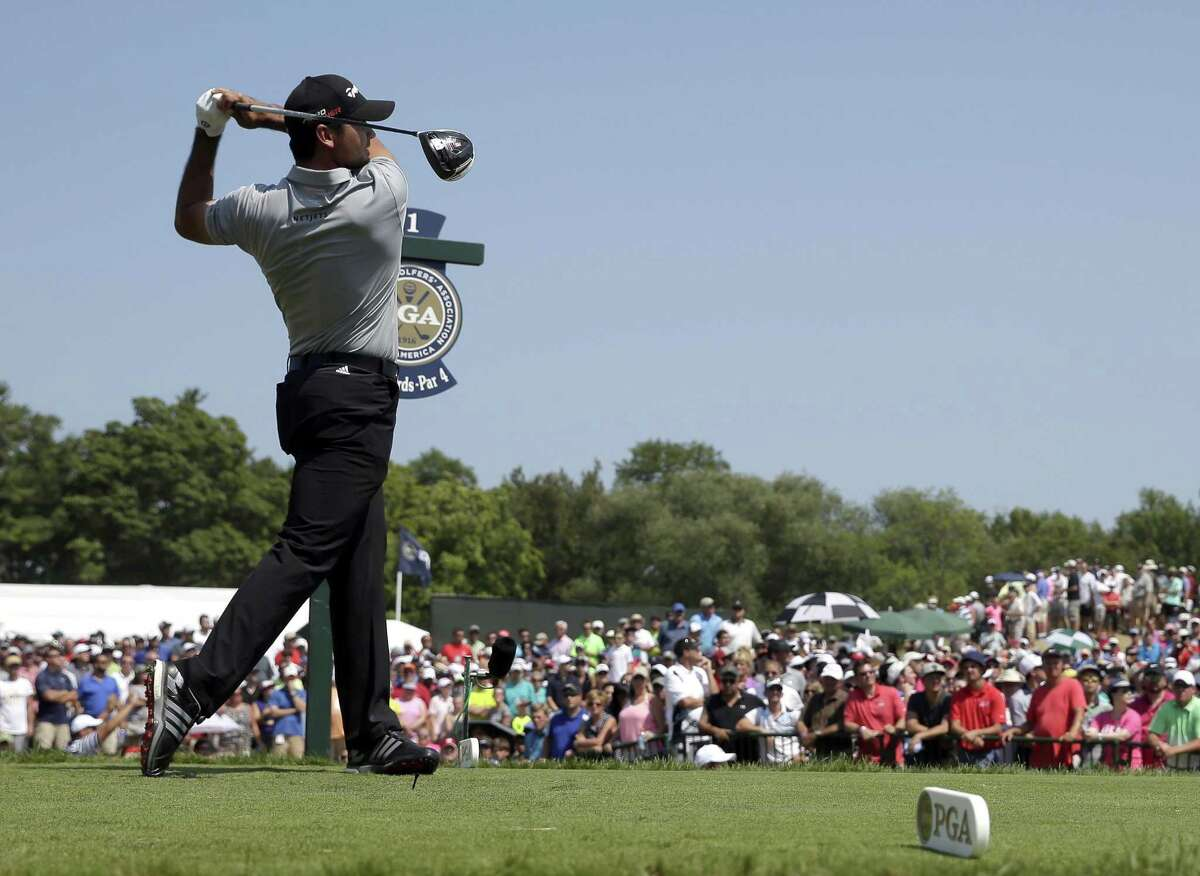 Jason Day hits a drive on the first hole during the second round of the PGA Championship Friday.