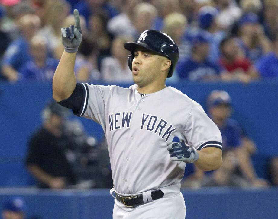 The Yankees' Carlos Beltran celebrates hitting a three-run homer against the Toronto Blue Jays in the eighth inning of the Yankees' 4-3 win. Photo: THE ASSOCIATED PRESS   / CP
