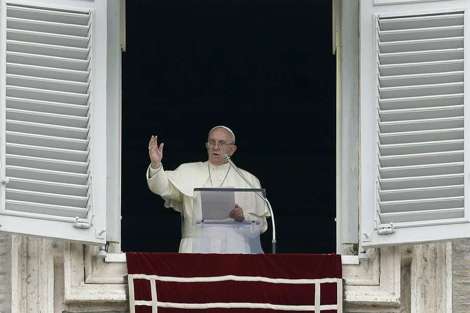 Pope Francis delivers a blessing from his studio's window overlooking St. Peter's Square on the occasion of the Angelus noon prayer at the Vatican on Sept. 13, 2015. Photo: AP Photo/Gregorio Borgia   / AP