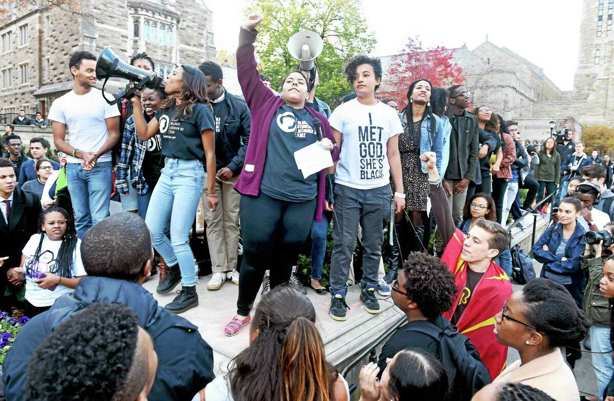 Yale University students and faculty rally Monday to demand that Yale become more inclusive to all students.