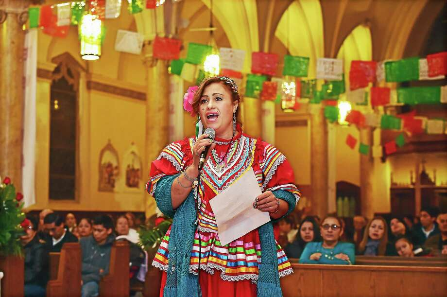 Suzana Castro performs at the Our Lady of Guadalupe celebration at St. Rose of Lima Church on Blatchley Avenue in New Haven, Friday, December 11, 2015. Photo: Catherine Avalone — New Haven Register   / New Haven RegisterThe Middletown Press
