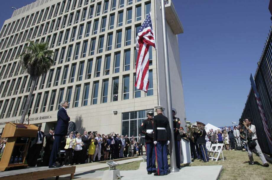 U.S. Secretary of State John Kerry watches the raising of the American flag Friday at the newly opened U.S. Embassy in Havana, Cuba. Kerry presided Friday over the flag raising ceremony in Havana as the United States and Cuba re-establish diplomatic relations after more than 54 years. Photo: Associated Press   / AP