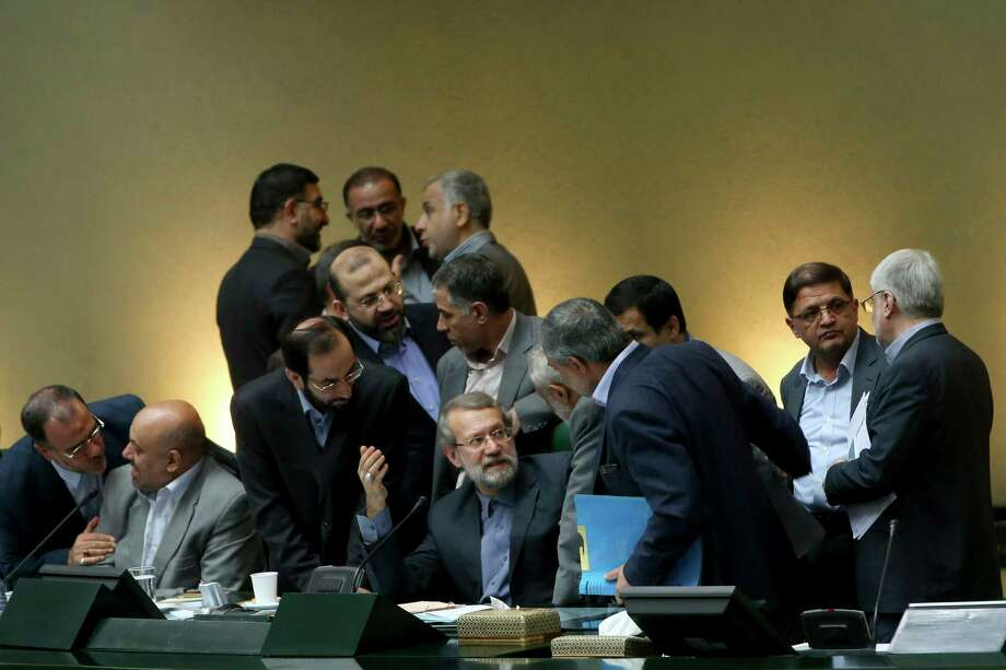 In this photo taken on Sunday, Oct. 11, 2015, Iran's parliament speaker Ali Larijani, center, speaks with lawmakers in an open session of parliament while discussing a bill on Iran's nuclear deal with world powers, in Tehran, Iran. Iran's parliament voted Tuesday to support implementing a landmark nuclear deal struck with world powers despite hard-line attempts to derail the bill, suggesting the historic accord will be carried out. Photo: AP Photo/Ebrahim Noroozi    / AP