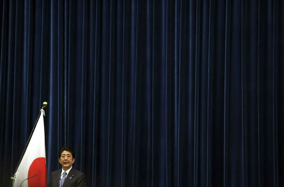 """Japanese Prime Minister Shinzo Abe delivers a statement to mark the 70th anniversary of the end of World War II during a press conference at his official residence in Tokyo Friday, Aug. 14, 2015. Japan's Prime Minister Shinzo Abe acknowledged Friday that Japan inflicted """"immeasurable damage and suffering"""" on innocent people in World War II, but stopped short of offering his own apology and said future generations of Japanese should not have to make them either."""