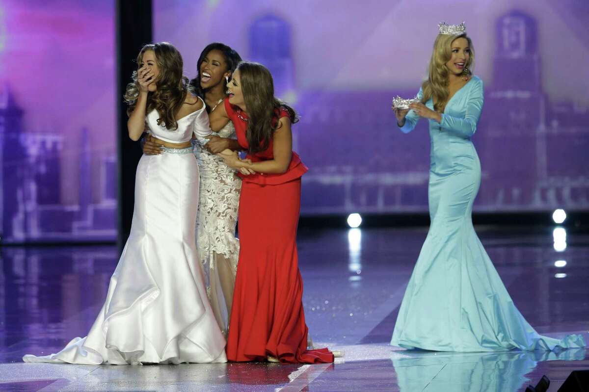 Miss Georgia Betty Cantrell, left, reacts after being named Miss America 2016 at the 2016 Miss America pageant, Sunday, Sept. 13, 2015, in Atlantic City, N.J. (AP Photo/Mel Evans)