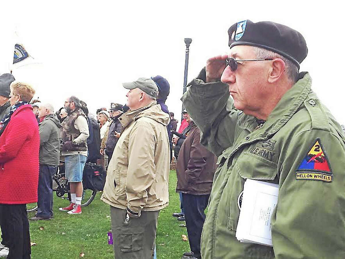 """West Haven Vietnam veteran William Benson — a leader of the Vietnam Veterans Memorial Committee who was a member of the Army's 3rd U.S. Infantry Regiment aka """"The Old Guard"""" — salutes the flag at West Haven's Veterans Day ceremony Wednesday morning at Bradley Point Park."""