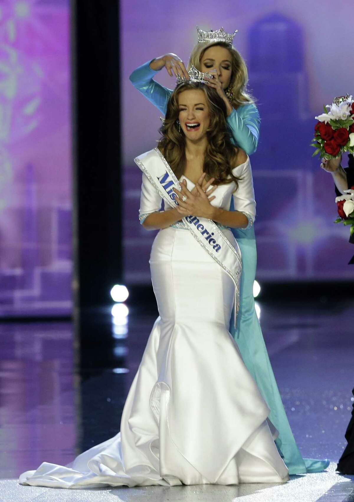 Miss Georgia Betty Cantrell is crowned Miss America 2016 by Miss America 2015 Kira Kazantsev at the 2016 Miss America pageant, Sunday, Sept. 13, 2015, in Atlantic City, N.J. (AP Photo/Mel Evans)