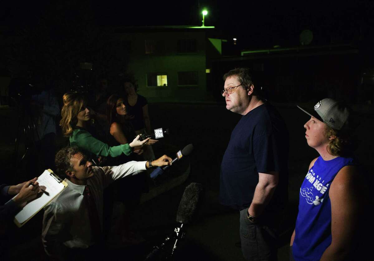 David Veatch, the father of Autumn Veatch, 16, along with family friend Chelsey Clark, right, speak to the media outside the Three Rivers Hospital in Brewster, Wash. on Monday, July 13, 2015.