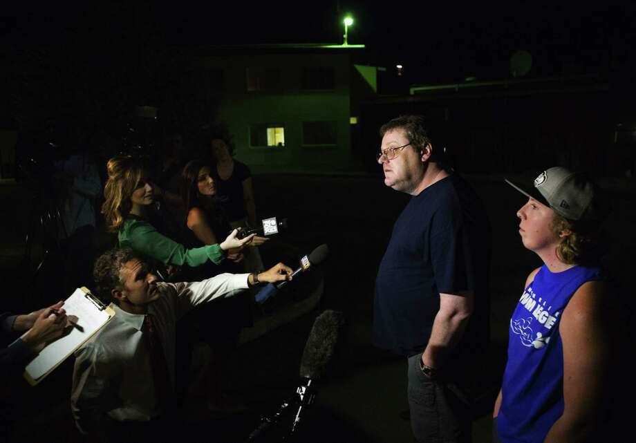 """David Veatch, the father of Autumn Veatch, 16, along with family friend Chelsey Clark, right, speak to the media outside the Three Rivers Hospital in Brewster, Wash. on Monday, July 13, 2015. """"Survivorman should be proud of her,"""" Veatch said. He says Autumn has no  training other than watching survival shows with him at home. 16-year-old Autumn had been missing since the plane she and her step-grandparents, Leland and Sharon Bowman, of Marion, Mont., crashed in the North Cascades on Saturday. Veatch, apparently the only survivor of the crash, hiked out of the crash site and managed to hike her way to the Mazama area.    (Lindsey Wasson/The Seattle Times via AP) Photo: AP / The Seattle Times"""