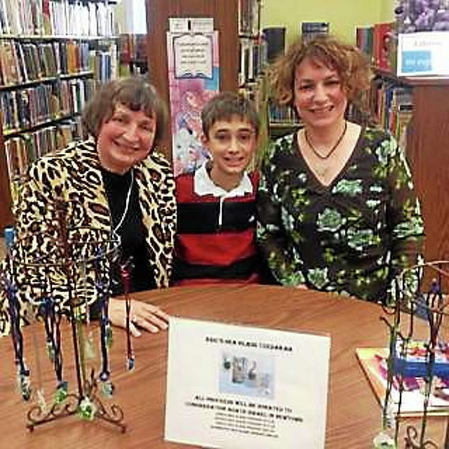 Arlene Golstein, left, and family supporting a library holiday event last December. Photo: CONTRIBUTED PHOTO