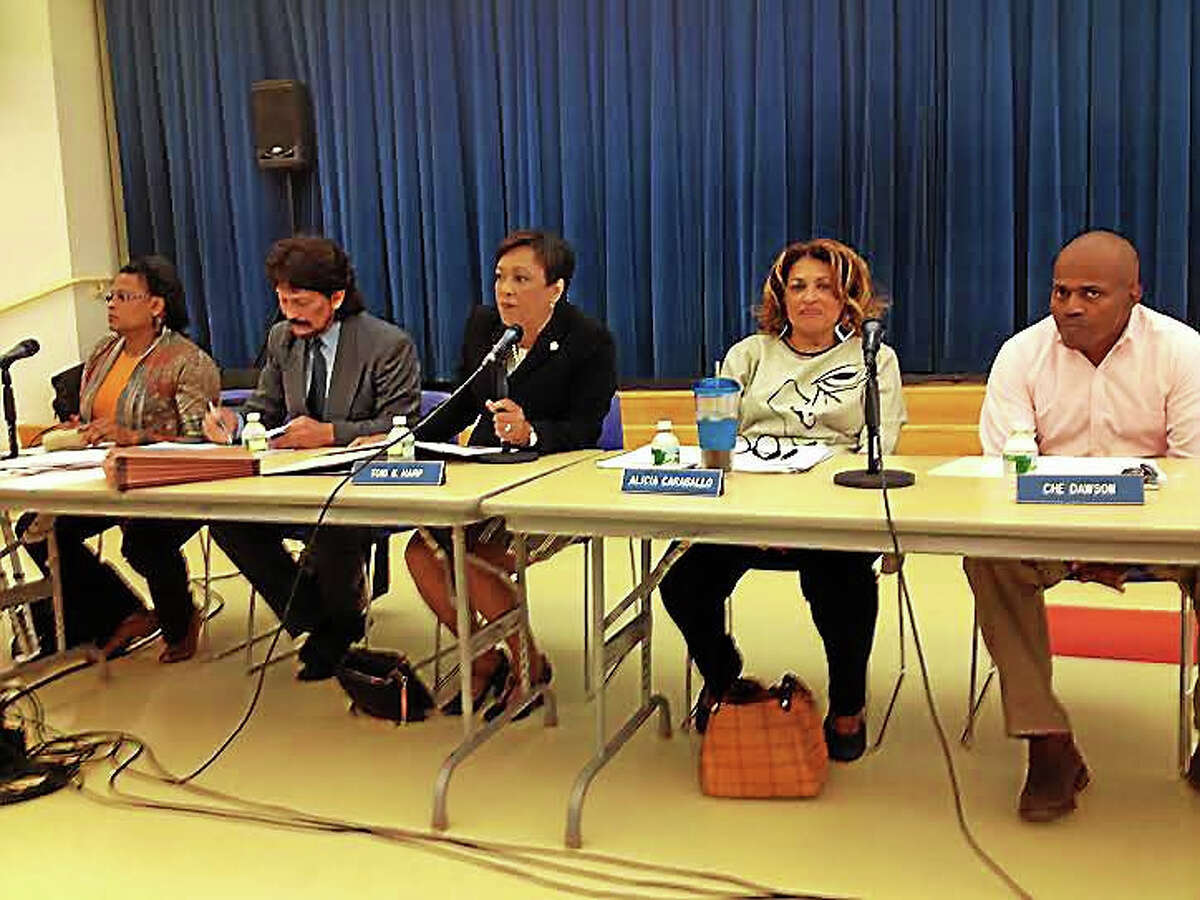 New Haven Mayor Toni N. Harp, center, outlines her 10-point plan for city education at a Board of Education meeting Tuesday. On her left are board members Susan Samuels and Carlos Torre, and on her right are board members Alicia Caraballo and Che Dawson.