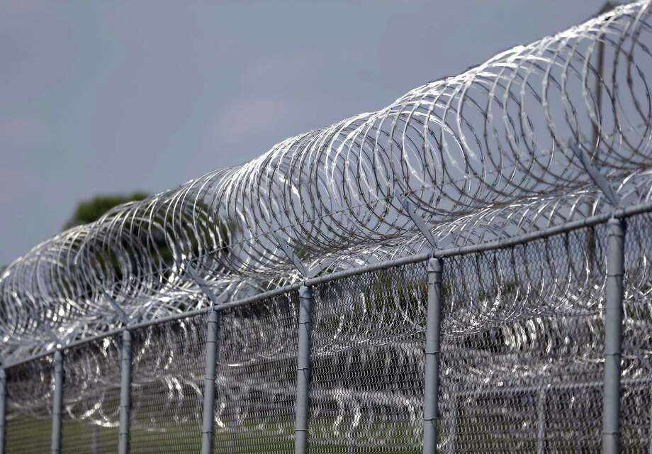 "This Tuesday, Aug. 18, 2015 photo shows razor wire surrounding the Rockville Correctional Facility in Rockville, Ind. Around 2007, the prison's superintendent Julie Stout noticed a change in inmate Paula Cooper. She participated in several programs at the facility; her favorite was culinary arts, where she excelled and became a tutor. ""She truly loved that,"" said Stout. ""She was always smiling."" Photo: THE ASSOCIATED PRESS / AP"
