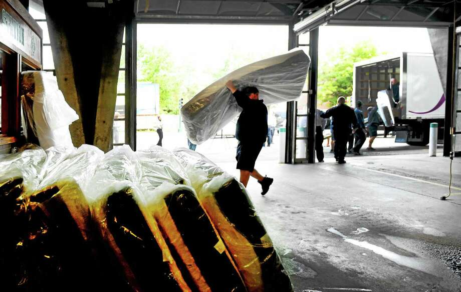 The New Haven Fire Department takes delivery of mattresses donated by Jordan's Furniture to the fire department at the NHFD Central Station in New Haven Wednesday. Photo: Peter Hvizdak — New Haven Register   / ?2015 Peter Hvizdak