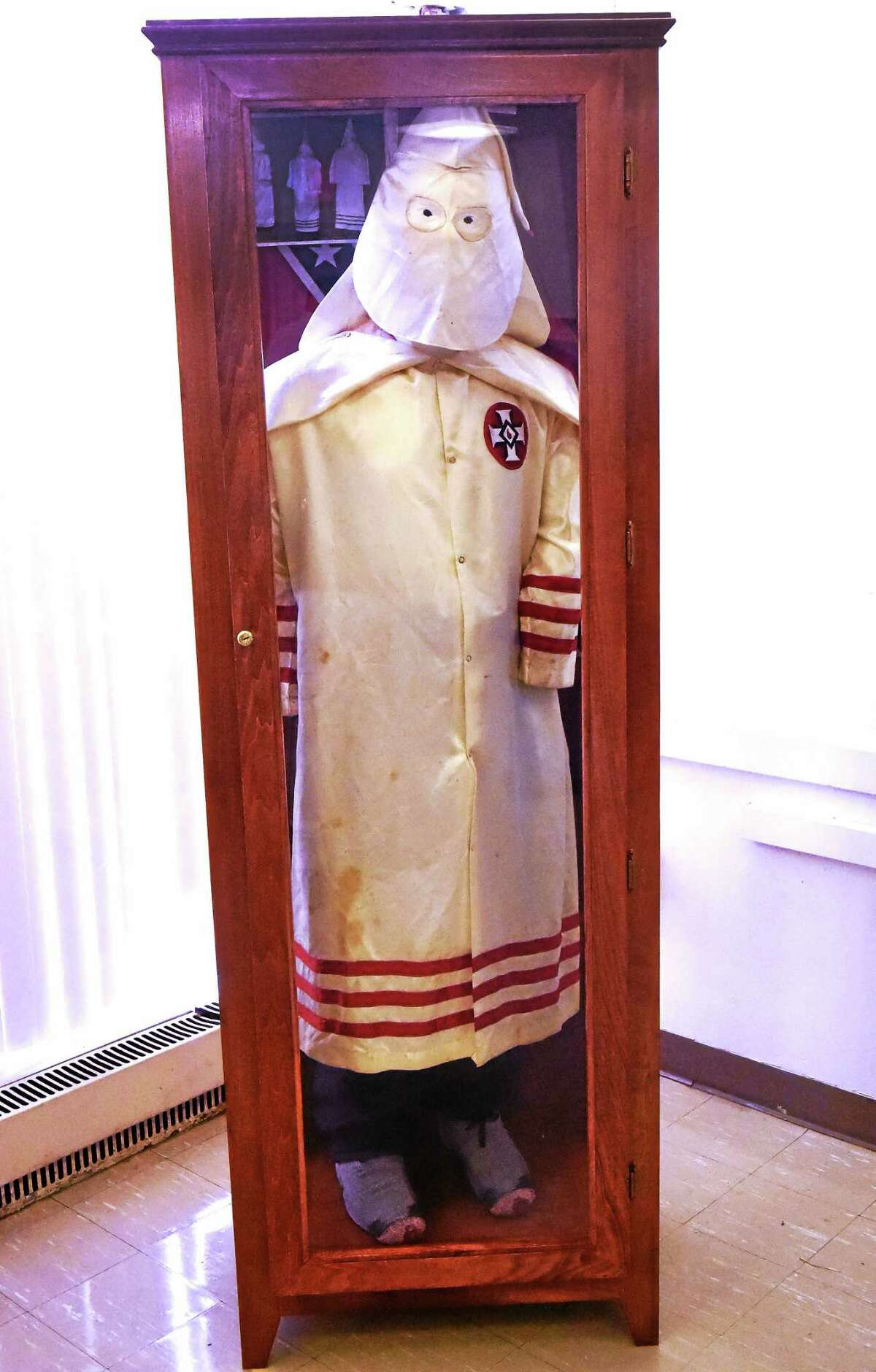 "An original Ku Klux Klan robe from the ""America's Distorted Images, An African American Collection"" exhibit."