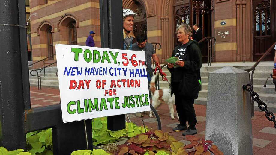 New Haven residents join in the National Day of Action on Climate with a rally outside City Hall Wednesday evening. Photo: Anna Bisaro — New Haven Register