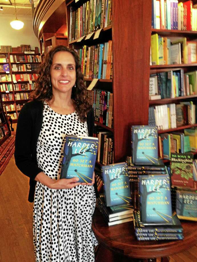 "Lori Fazio, general manager of R.J. Julia Booksellers in Madison, shows copies of Harper Lee's novel, ""Go Set a Watchman,"" which went on sale Tuesday. Photo: Ed Stannard — New Haven Register"