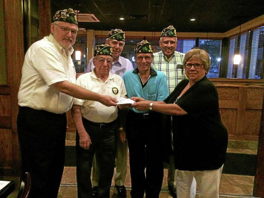 From left, American Legion Emil Senger Post 10 Commander Micheal Kearney accepts a check Tuesday from Founders Day Association President Linda Bellavance, while post 10 members look on. Photo: Contributed Photo
