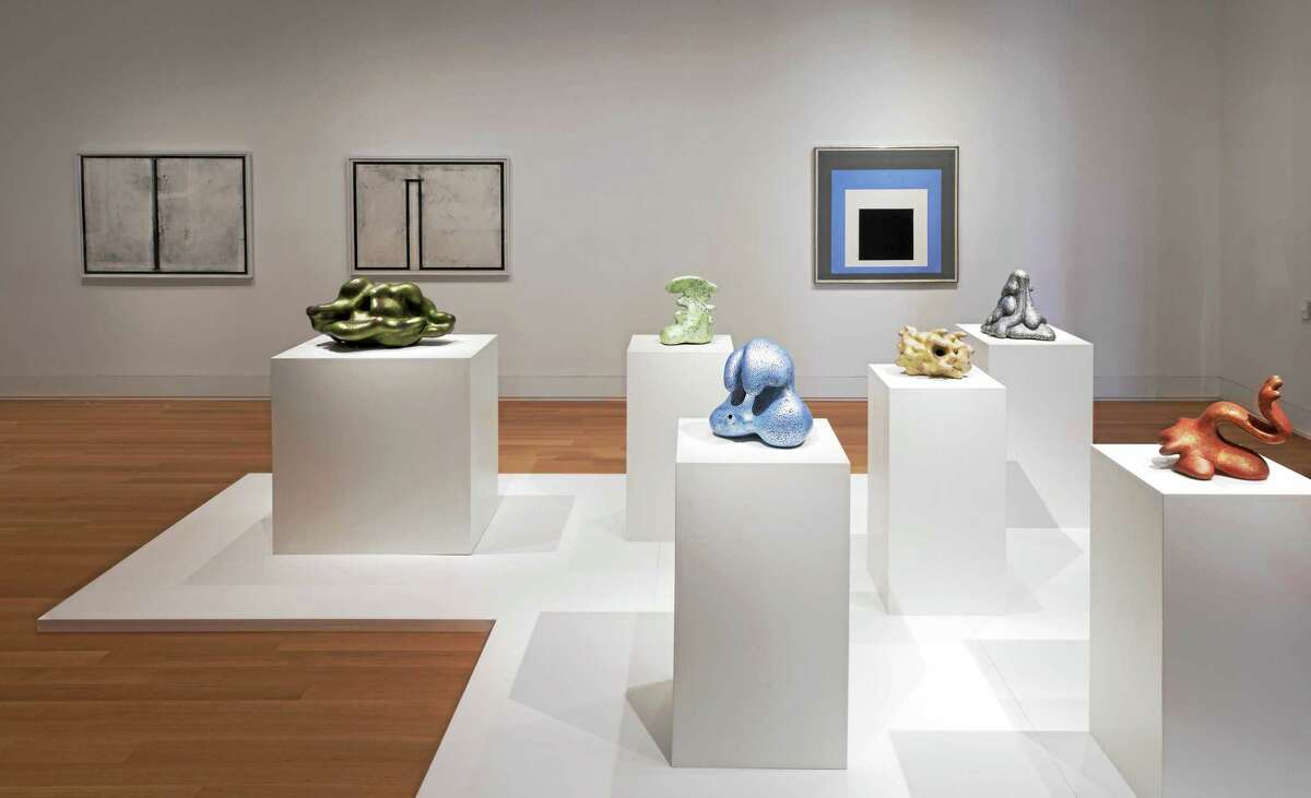 Kenneth Price's painted stoneware is set against the backdrop of a Josef Albers painting, right.