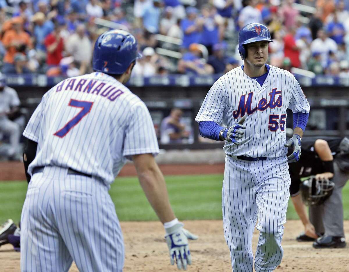 New York Mets' Kelly Johnson is greeted by Travis d'Arnaud after he hit a home run during the fifth inning against the Colorado Rockies on Thursday.