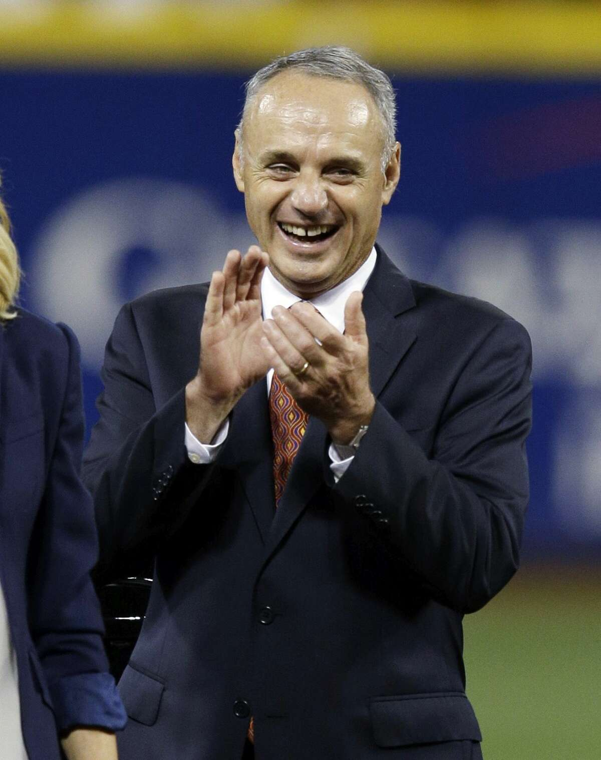 MLB Commissioner Rob Manfred claps after the MLB All-Star game in July.