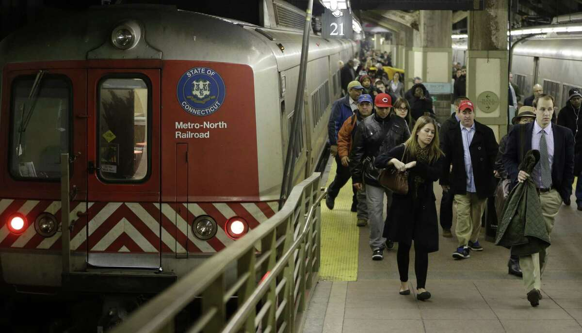 Passengers disembark from a Metro-North Railroad car after it pulled into Grand Central Terminal in New York.