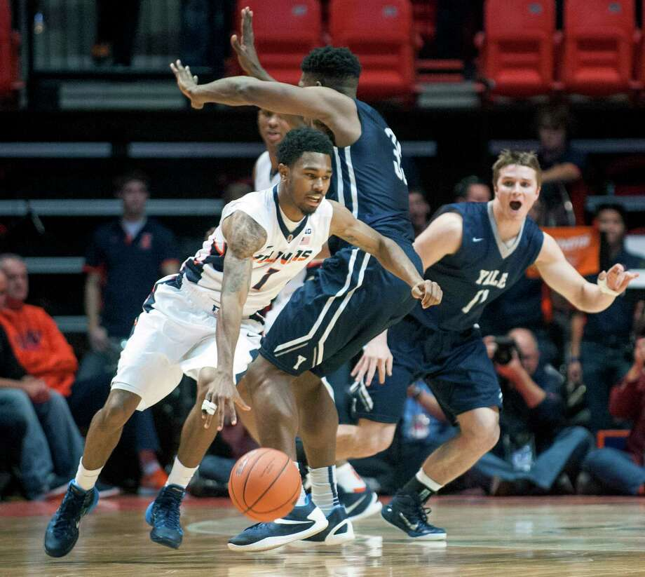 Illinois' guard Jaylon Tate (1) drives the ball around Yale's forward Brandon Sherrod (35) as Yale's guard Makai Mason (11) looks on  during the second half of an NCAA college basketball game, Wednesday, Dec. 9, 2015 in Champaign, Ill. (AP Photo/Heather Coit) Photo: AP / FR3604 AP