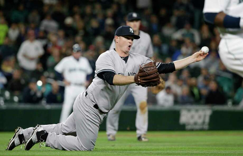 FILE- In this June 2, 2015, file photo, New York Yankees relief pitcher Justin Wilson throws to first to complete a double play against the Seattle Mariners in the 10th inning of a baseball game in Seattle. In a trade was announced on Wednesday, Dec. 9, the Detroit Tigers have acquired Wilson from the New York Yankees for minor league right-handers Luis Cessa and Chad Green. (AP Photo/Elaine Thompson, File) Photo: AP / AP