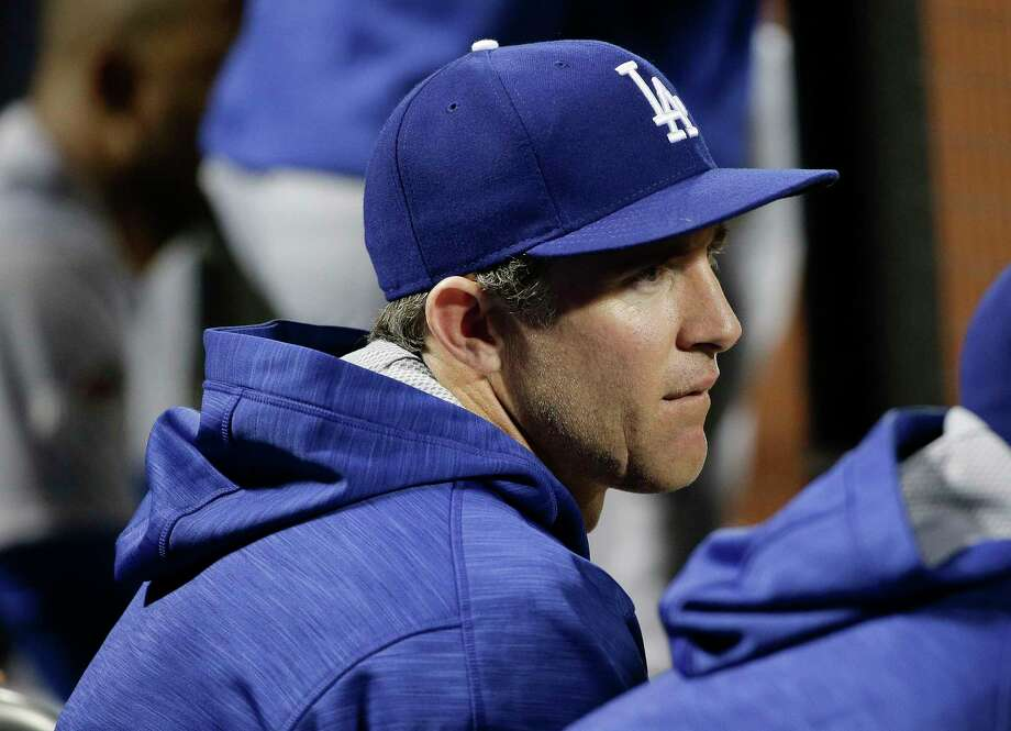 The Los Angeles Dodgers' Chase Utley watches from the dugout during the ninth inning of Game 3 of the National League division series against the Mets on Tuesday in New York. Photo: Julie Jacobson — The Associated Press   / AP