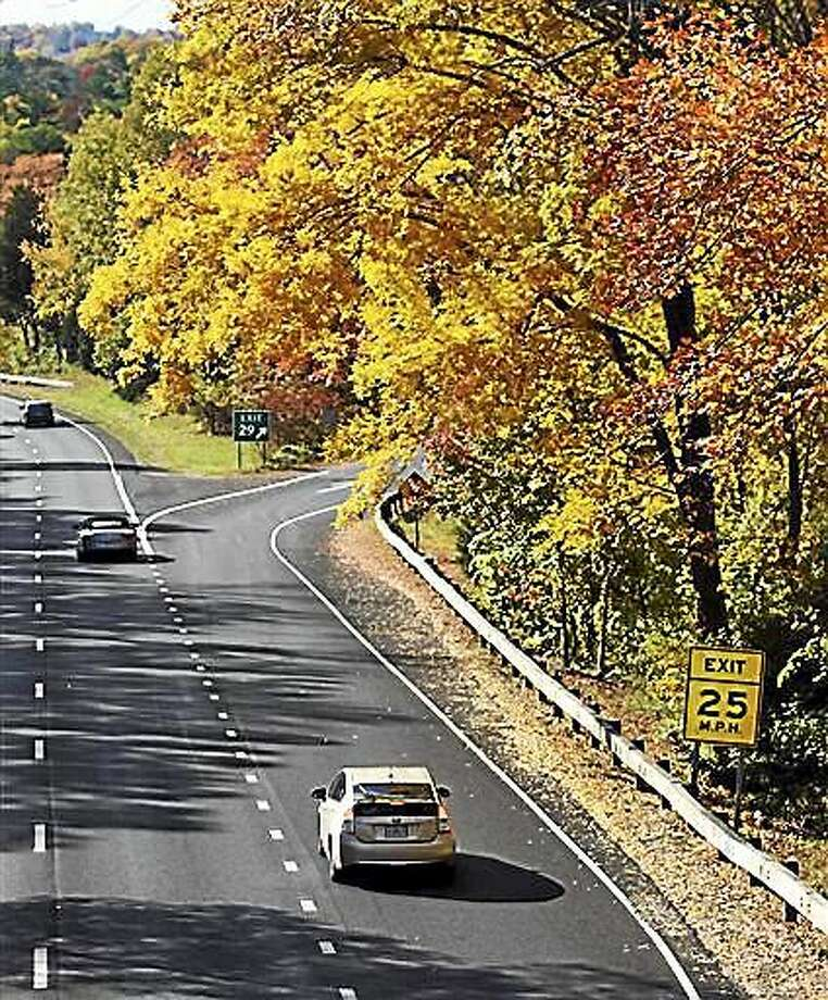 Tyler Sizemore/Hearst Connecticut Media via AP   In this Oct. 30, 2014 photo, fall foliage lines the Merritt Parkway by the Lake Avenue exit in Greenwich Conn. A transportation overhaul proposed in 2015 by Gov. Dannel P. Malloy calls for spending nearly $31 billion on highways. The stately 38-mile parkway that winds through the wealthiest part of the state would remain little changed from when it was built in 1940, and advocates are intent on keeping it that way. Photo: AP / Hearst Connecticut Media