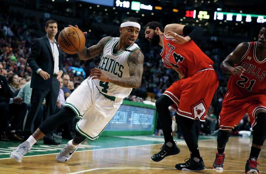 Boston Celtics' Isaiah Thomas (4) drives past Chicago Bulls' Nikola Mirotic (44) during the fourth quarter of an NBA basketball game in Boston, Wednesday, Dec. 9, 2015. The Celtics won 105-100. (AP Photo/Michael Dwyer) Photo: AP / AP