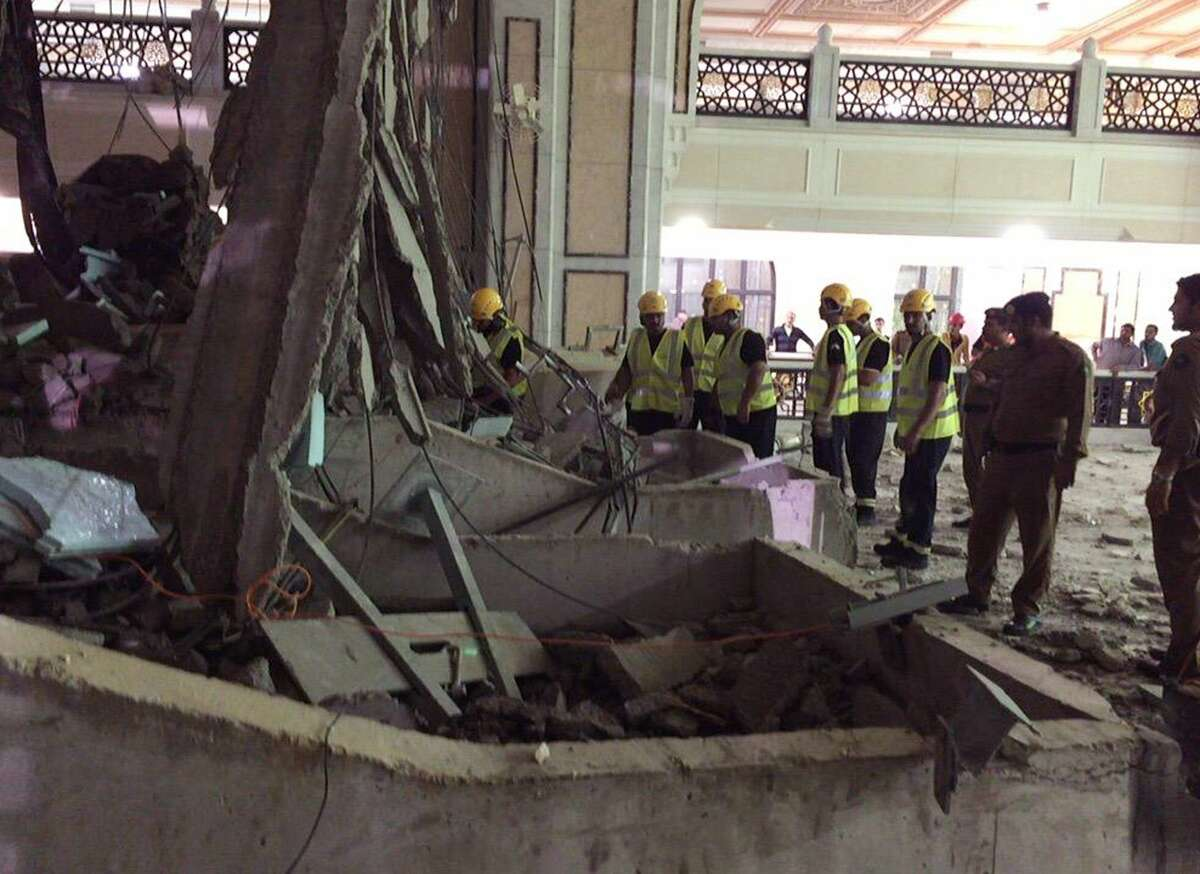 In this image released by the Saudi Interior Ministryís General Directorate of Civil Defense, Civil Defense personnel inspect the damage at the Grand Mosque in Mecca after a crane collapsed killing dozens, Friday, Sept. 11, 2015. The accident happened as pilgrims from around the world converged on the city, Islam's holiest site, for the annual Hajj pilgrimage, which takes place this month.