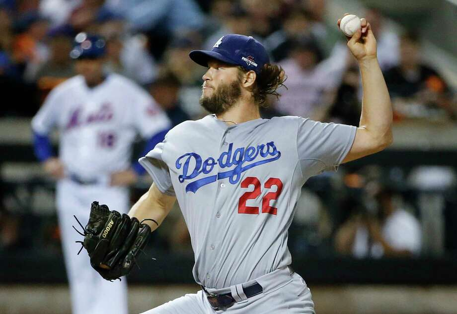 The Dodgers' Clayton Kershaw (22) delivers against the New York Mets during the first inning of Game 4 of the National League Division Series. The Dodgers won 3-1 to force a fifth and deciding game. Photo: Kathy Willens — The Associated Press   / AP