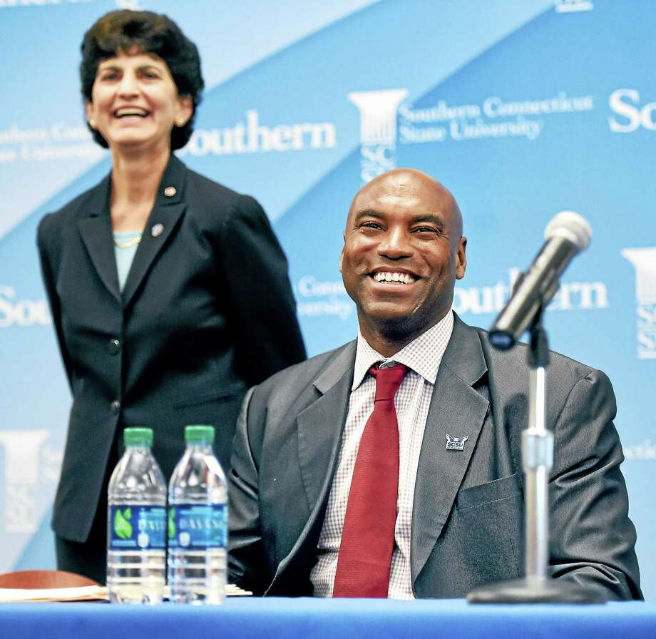 Arnold Gold — Register  Southern Connecticut State President Mary Papazian, left, and Scott Burrell share a laugh during the press conference announcing Burrell as the new Southern Connecticut State men's basketball coach. Photo: Journal Register Co.