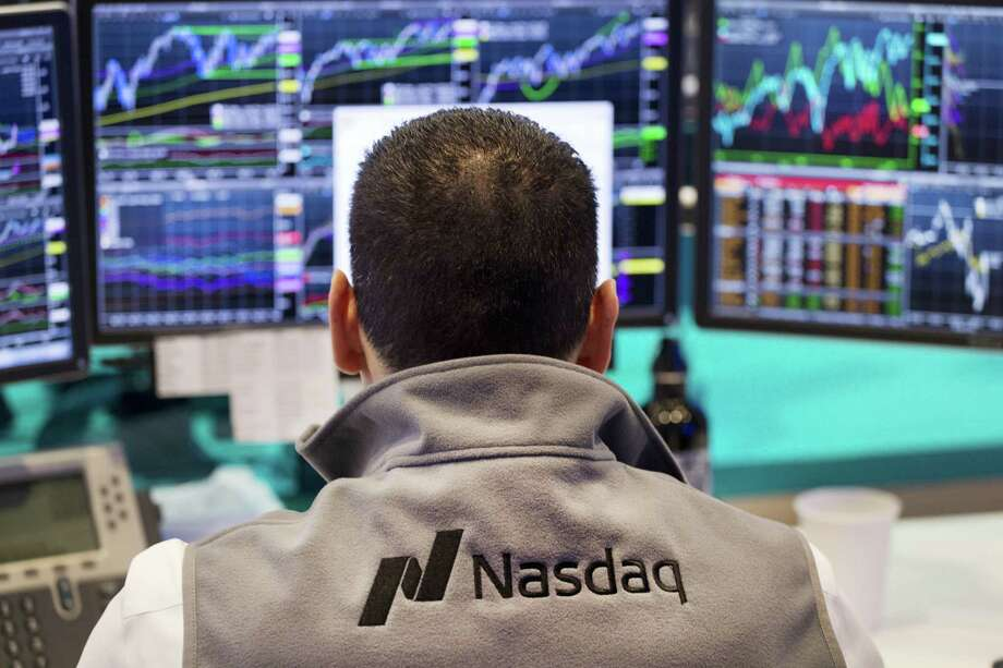 FILE - In this April 16, 2015 file photo, a Nasdaq employee monitors prices at the Nasdaq MarketSite, in New York. The tech-driven Nasdaq hit another in a string of all-time highs last month as technology re-established itself as the dominant sector in the U.S. stock market, harking back to its last heyday during the Internet boom of the late 1990s. Photo: THE ASSOCIATED PRESS / AP