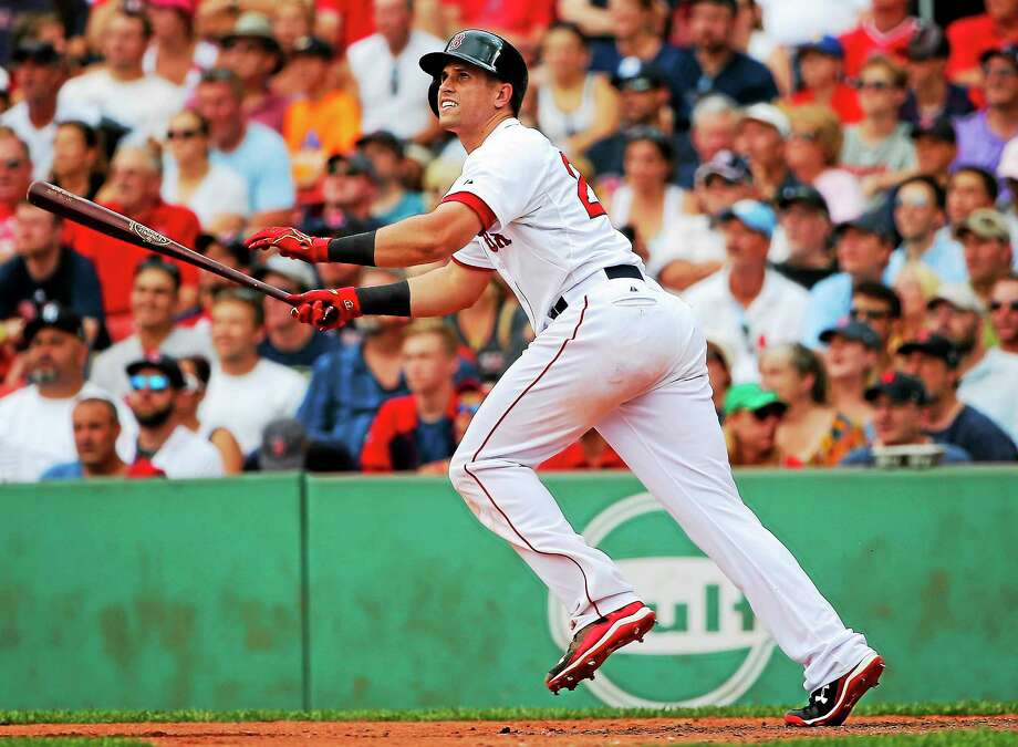 The Boston Red Sox traded Garin Cecchini to Milwaukee. Photo: Winslow Townson — The Associated Press File Photo   / FR170221 AP