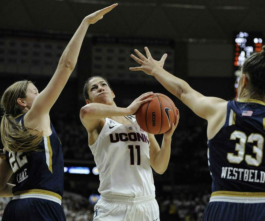 UConn's Kia Nurse shoots between Notre Dame's Madison Cable, left, and Kathryn Westbeld during the Huskies' win on Sunday. Photo: Jessica Hill — The Associated Press   / FR125654 AP