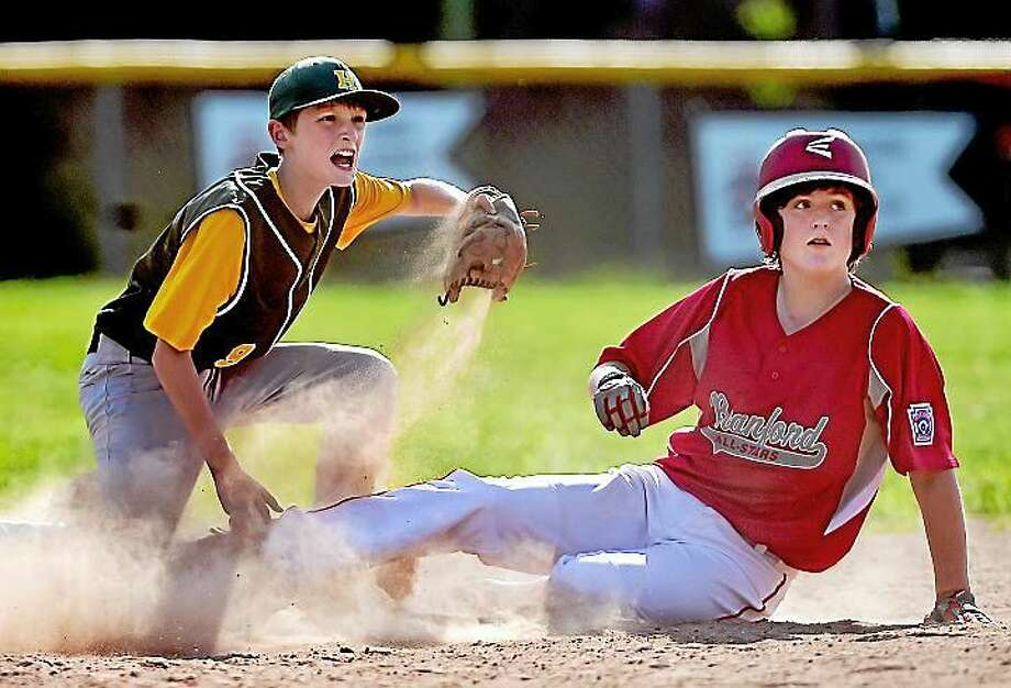 Hamden's Michael Coggins looks for the umpire's call at second against Branford in the District 4 championship game against Hamden and Branford at the Dewitt Jones Field in New Haven Saturday. The Hamden Dragons won, 17-3 in 4 innings. Photo: Catherine Avalone — New Haven Register