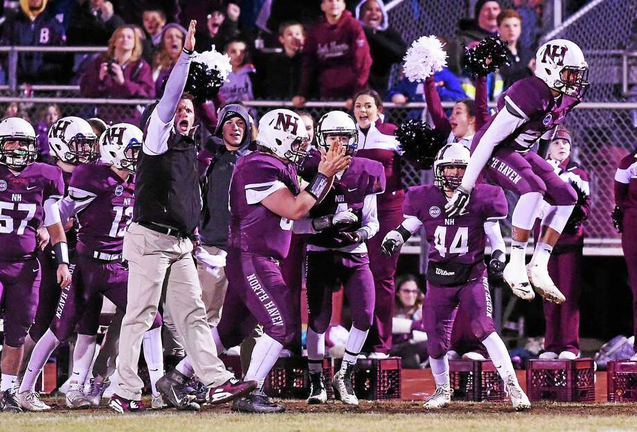 The North Haven football team celebrates during the Class L semifinals at Vanacore Field. The Indians are playing in their first football state championship Saturday vs. New Canaan. Photo: Arnold Gold -- New Haven Register
