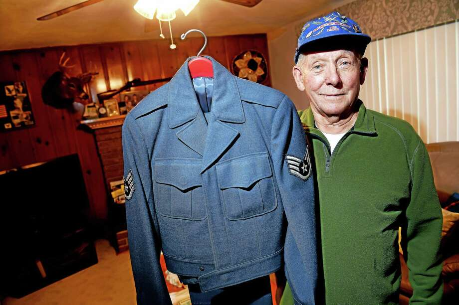 Edward Kiczyinski is photographed at his Branford home with his uniform from his days in the Air Force 39th Fighter Squadron. Photo: Arnold Gold — New Haven Register